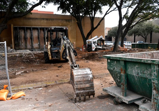 Workers break concrete Wednesdau with a jackhammer at Vera Minter Memorial Park in downtown Abilene. The park is being renovated and will include new water features.