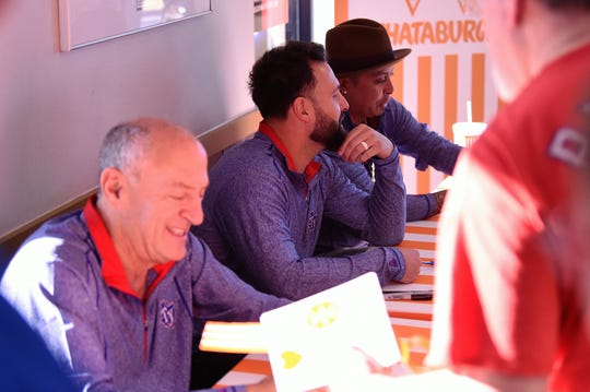 Texas Rangers radio broadcaster Eric Nadal, left, and pitchers Nick Goody and Jesse Chavez sign autographs and talk to fans during the Texas Rangers Winter Caravan stop at the Whataburger on Danville in Abilene on Tuesday, Jan. 14, 2020.