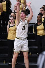 Abilene High's Jackson Stevens (21) follows through on a 3-point shot against Haltom City Haltom at on Tuesday. Stevens knocked down two 3-pointers and finished with 10 points as the Eagles improved to 4-0 in District 3-6A with the 52-39 win.