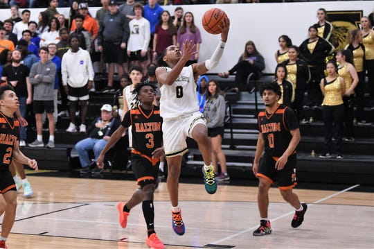 Abilene High's Pooh Johnson (0) goes up for a layup against Haltom City Haltom at Eagle Gym on Tuesday. The Eagles led start to finish and improved to 4-0 in District 3-6A with the 52-39 win.
