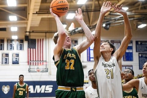 Reynolds Ethan Hefner (32 tries to shoot over Roberson's Cameron Phillips (21) during the Rams' 47-45 win on January 14, 2020.