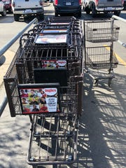 Ingles Markets CFO Ron Freeman said the company has about an equal number of larger carts, left, and its two-tiered smaller carts, right.
