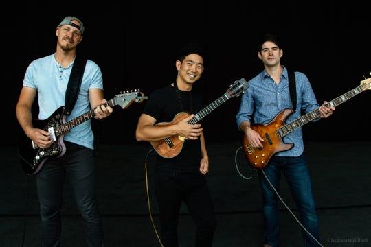 Ukelele virtuoso Jake Shimabukuro, bassist Nolan Verner, and guitarist Dave Preston