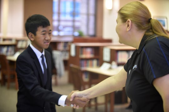 Battle Creek Central High School freshmen went through mock interviews with volunteers from the local business community at the school's media center on Thursday, November 21, 2019.