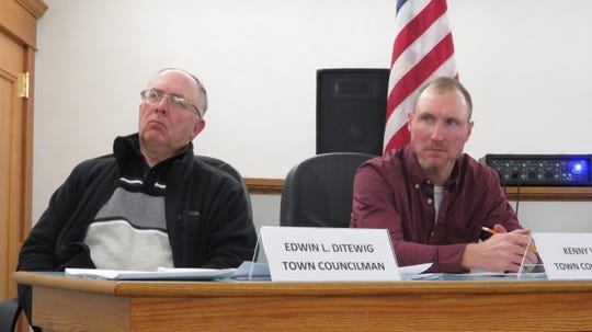 Town of Sanford Board Members Edwin Ditewig, (left), and Kenny Wist listen to comments at the Jan. 14, 2020 meeting in Deposit.