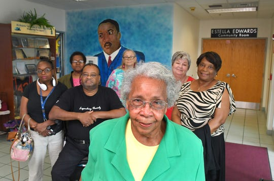 Members of Friends of the Martin Luther King, Jr. Public Library, which is located on University Blvd. in Melbourne. Photo shows Friends President Mary Baker (in green) with Patricia Williams, Rita Hewett, Augusta Williams, Jr., Bonnie Miller, Catherine Bottomlee, and Victoria Windross.