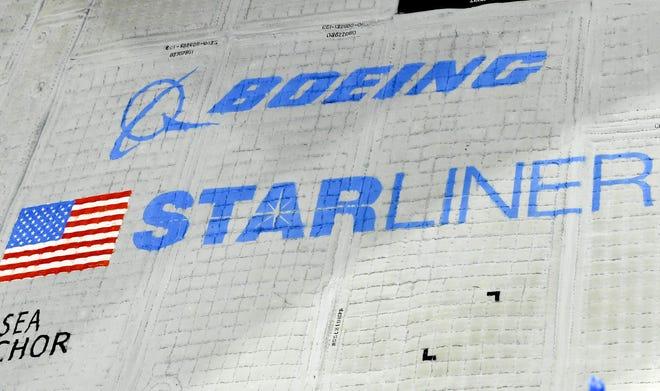 Members of the news media get a closer look at Boeing's Starliner capsule.