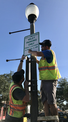 Melbourne traffic engineering workers install a valet parking sign Wednesday morning in front of Matt's Casbah on New Haven Avenue.
