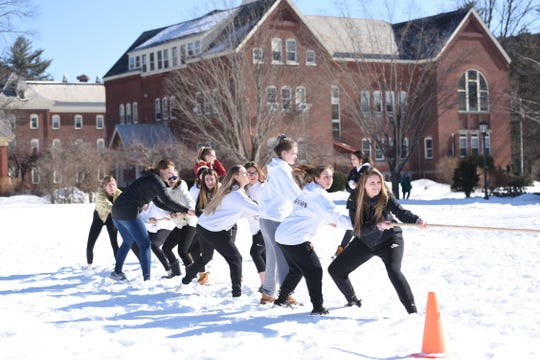 Vermont Academy students participate in a game of tug-of-war during the annual Winter Carnival.