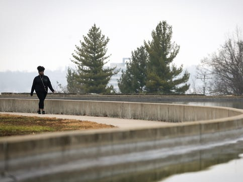 Chericka Turner, of Norwood, walks around Mirror Lake, Wednesday, Jan. 15, 2020, at Eden Park in Cincinnati. Cincinnati has experienced 25 consecutive days of above normal temperatures since Dec. 20, according to the National Weather Service.