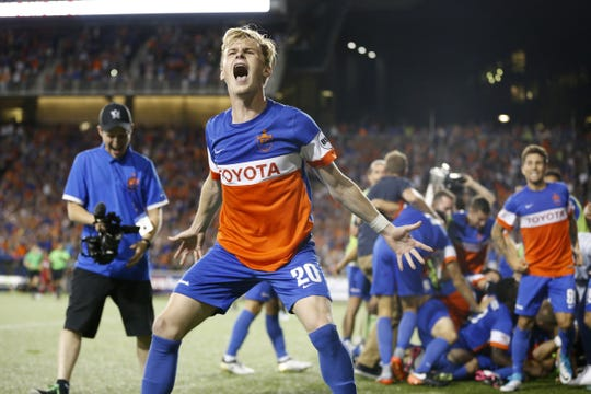 FC Cincinnati forward Jimmy McLaughlin (20) celebrates the win after penalty kicks during the Lamar Hunt US Open Cup match between the Chicago Fire and FC Cincinnati, Wednesday, June 28, 2017, at Nippert Stadium in Cincinnati.
