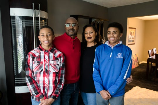 Ericka King-Betts, MLK Coalition president, and her husband, Darrell Betts Jr., stand with their sons, Simeon, 12, left, and Dior, 15, at their home on Wednesday, Jan. 15, 2020 in Springfield Township. Simeon and Dior carry the Martin Luther King Jr. Coalition Inc. banner at the MLK Day parade the year prior and plan to do it again this year.