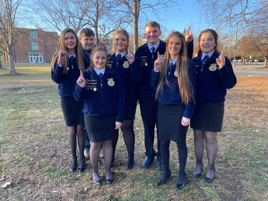 The Parliamentary Procedure Team poses after finding out they are the State Champions. From left: Alisha Boone, Landen Tull, Kyra Davidson, Carly McClure, Luke Jennings, Emily Hardewig, and Audrey Pinger.