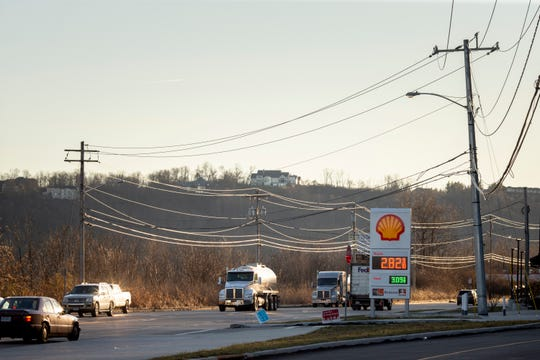 Vehicles travel along River Road in East Price Hill on Wednesday, January 8, 2019. West Side developer Ray Brown says he's been working on getting a traffic light by this gas station for over a year.