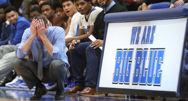 Hamilton head coach Kevin Higgins reacts during the Big Blue's 72-47 win over Lakota West, Tuesday, Jan. 14, 2020.
