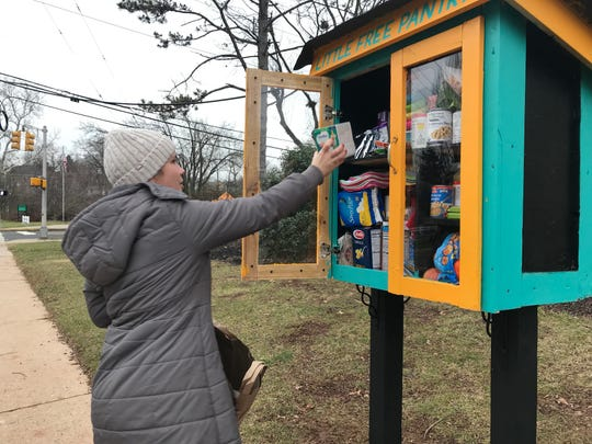 Danielle Mann of Somerville adds items to the new Little Free Pantry on the grounds of the Greater Somerset County YMCA in Somerville. The creation of Hillsborough High School sophomore Shailee Shah, 15, the Little Free Pantry aims to help alieviate food insecurity and waste though the creation in communities.