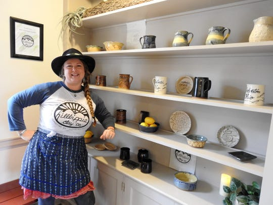 Rachel Hall of Hillbippie Clay with some of her functional pitchers, cups, plates and bowls for sale at the new store in Roscoe Village. Most of her wares are safe for eating and drinking, and can be put in the microwave, oven and dishwasher.