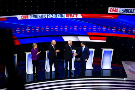 U.S. Sen. Elizabeth Warren, Former Vice President Joe Biden, U.S. Sen. Bernie Sanders and Former South Bend Mayor Pete Buttigieg take the stage during the CNN/Des Moines Register Democratic Debate on Tuesday, Jan. 14, 2020, in Sheslow Auditorium on the Drake University campus in Des Moines, Iowa.