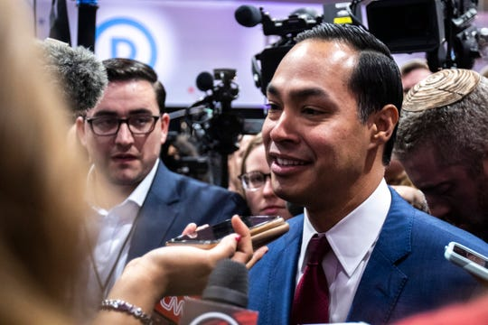 Julian Castro speaks about Elizabeth Warren with reporters in the spin room after the CNN/Des Moines Register Democratic Presidential Debate, Tuesday, Jan. 14, 2020, on the Drake University campus in Des Moines, Iowa.
