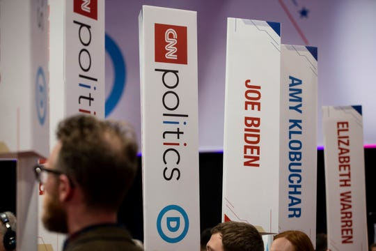 Signs denoting candidates wait in the spin room following the CNN/Des Moines Register Democratic Presidential Debate at Drake University's Sheslow Auditorium on Tuesday, Jan. 14, 2020, in Des Moines.