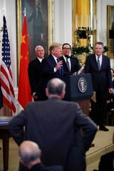 """President Donald Trump speaks about Sen. Chuck Grassley, R-Iowa, standing foreground, before signing """"phase one"""" of a US China trade agreement with Chinese Vice Premier Liu He, in the East Room of the White House, Wednesday Jan. 15, 2020, in Washington. With the President from left are Vice President Mike Pence, Treasury Secretary Stephen Mnuchin and U.S. Trade Representative Robert Lighthizer. (AP Photo/ Steve Helber)"""