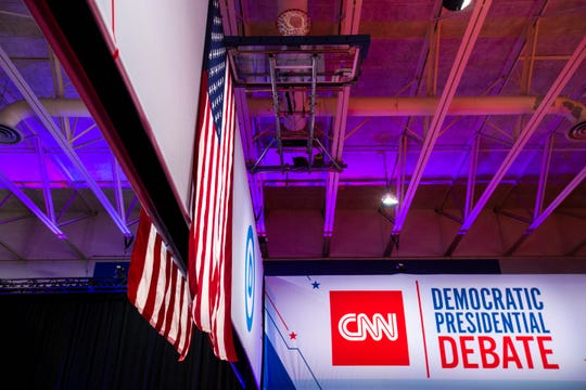 American flags hang from the rafters alongside basketball hoops near the spin room during the CNN/Des Moines Register Democratic Presidential Debate, Tuesday, Jan. 14, 2020, on the Drake University campus in Des Moines, Iowa.