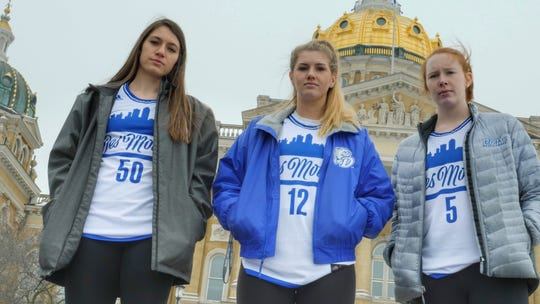 "The Drake women's basketball team will be wearing special Des Moines-themed jerseys on Jan. 31 as part of the university's ""hometown team"" weekend. Pictured from left are women's basketball team members Sara Rhine, Brenni Rose and Becca Hittner."