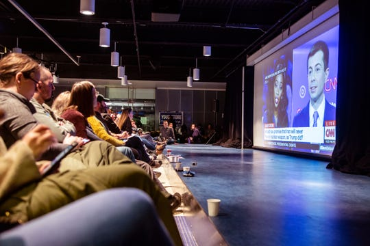 Attendees at a watch party for Sen. Elizabeth Warren at Drake University during the CNN/Des Moines Register Democratic presidential debate in Sheslow Auditorium at Drake UniversityTuesday, Jan. 14, 2020.