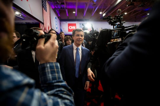 Former South Bend, Indiana Mayor and 2020 Democratic presidential candidate Pete Buttigieg and his partner Chasten leave the spin room following the CNN/Des Moines Register Democratic Presidential Debate at Drake University's Sheslow Auditorium on Tuesday, Jan. 14, 2020, in Des Moines.