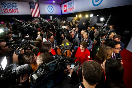 Minnesota Senator and 2020 Democratic presidential candidate Amy Klobuchar talks to the press in the spin room following the CNN/Des Moines Register Democratic Presidential Debate at Drake University's Sheslow Auditorium on Tuesday, Jan. 14, 2020, in Des Moines.