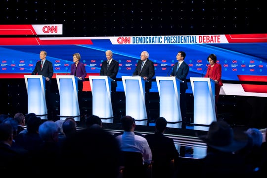 Tom Steyer, U.S. Sen. Elizabeth Warren, Former Vice President Joe Biden, U.S. Sen. Bernie Sanders, Former South Bend Mayor Pete Buttigieg, and U.S. Sen. Amy Klobuchar on stage during the CNN/Des Moines Register Democratic Debate on Tuesday, Jan. 14, 2020, in Sheslow Auditorium on the Drake University campus in Des Moines, Iowa.