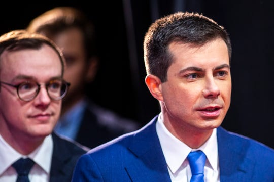 Democratic presidential candidate Pete Buttigieg, former mayor of South Bend, Indiana, (right) walks out from backstage with his husband Chasten Buttigieg before talking with reporters in the spin room after the CNN/Des Moines Register Democratic Presidential Debate, Tuesday, Jan. 14, 2020, on the Drake University campus in Des Moines, Iowa.