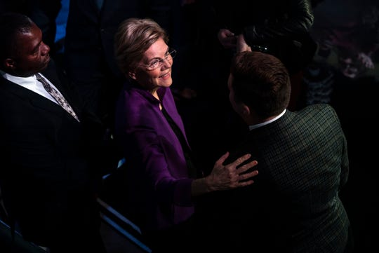 U.S. Sen. Elizabeth Warren talks with a person in the crowd after the CNN/Des Moines Register Democratic Debate on Tuesday, Jan. 14, 2020, in Sheslow Auditorium on the Drake University campus in Des Moines, Iowa.