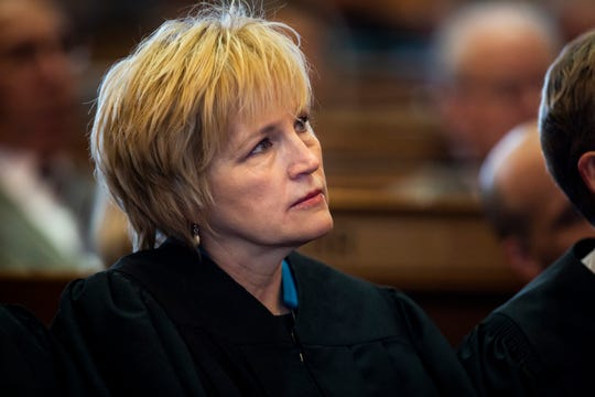 Justice Susan Christensen watches as Acting Chief Justice David Wiggins delivers the Condition of the Judiciary at the Iowa State Capitol on Wednesday, Jan. 15, 2020, in Des Moines.