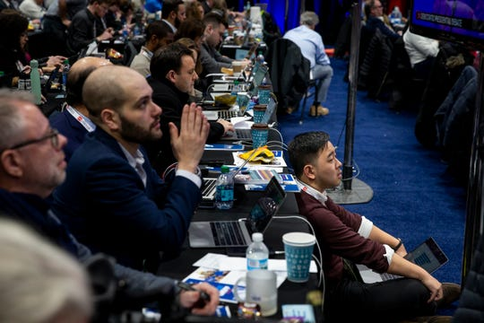 Members of the media work from the filing center in the spin room following the CNN/Des Moines Register Democratic Presidential Debate at Drake University's Sheslow Auditorium on Tuesday, Jan. 14, 2020, in Des Moines.