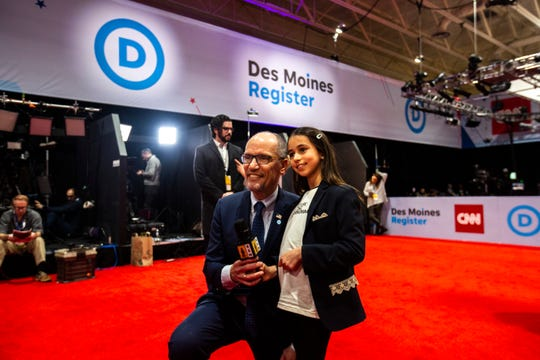Tom Perez, Chair of the Democratic National Committee, (left) poses for a photo with Lila Desai, 8, during the CNN/Des Moines Register Democratic Presidential Debate, Tuesday, Jan. 14, 2020, on the Drake University campus in Des Moines, Iowa.