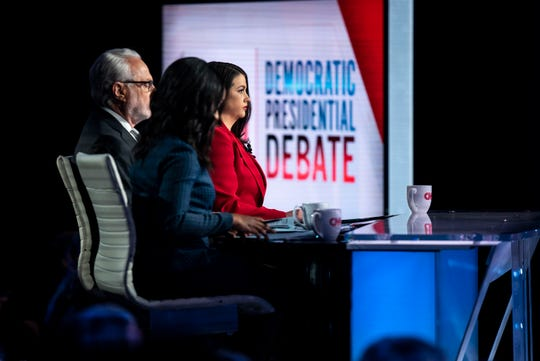 The Des Moines Register's Brianne Pfannenstiel asks a question of one of the candidates during the CNN/Des Moines Register Democratic Debate on Tuesday, Jan. 14, 2020, in Sheslow Auditorium on the Drake University campus in Des Moines, Iowa.
