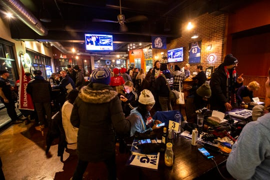 Potential caucus-goers attend a watch party for the CNN/Des Moines Register Democratic Presidential Debate, Tuesday, Jan. 14, 2020, at Papa Keno's Pizzeria in Des Moines, Iowa.