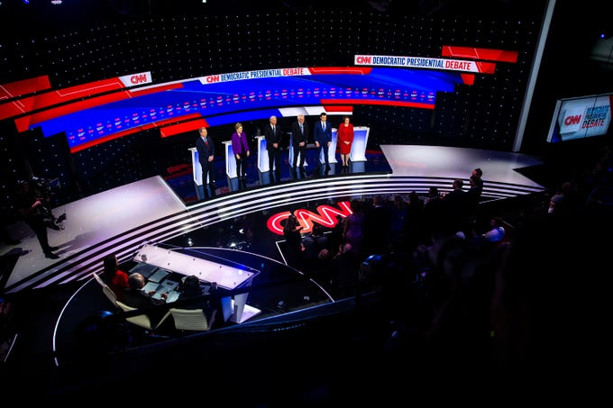 Tom Steyer, U.S. Sen. Elizabeth Warren, Former Vice President Joe Biden, U.S. Sen. Bernie Sanders, Former South Bend Mayor Pete Buttigieg, and U.S. Sen. Amy Klobuchar take the stage for the CNN/Des Moines Register Democratic Debate on Tuesday, Jan. 14, 2020, in Sheslow Auditorium on the Drake University campus in Des Moines, Iowa.