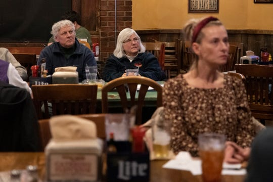 Spectators watch the CNN/Des Moines Register debate of six Democratic presidential candidates on Jan. 14, 2020 at Wobby Boots in Clive.