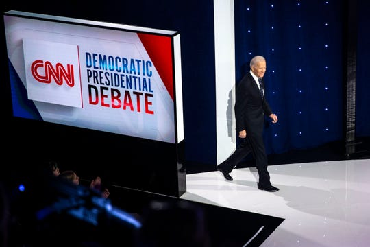 Former Vice President Joe Biden takes the stage during the CNN/Des Moines Register Democratic Debate on Tuesday, Jan. 14, 2020, in Sheslow Auditorium on the Drake University campus in Des Moines, Iowa.