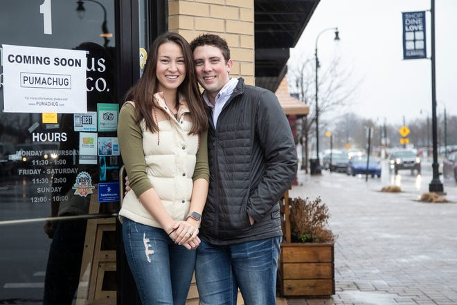 Andrea Williams and her husband Tyler Williams in front of their upcoming Pumachug pub in Clawson, Saturday, Jan. 11, 2020.