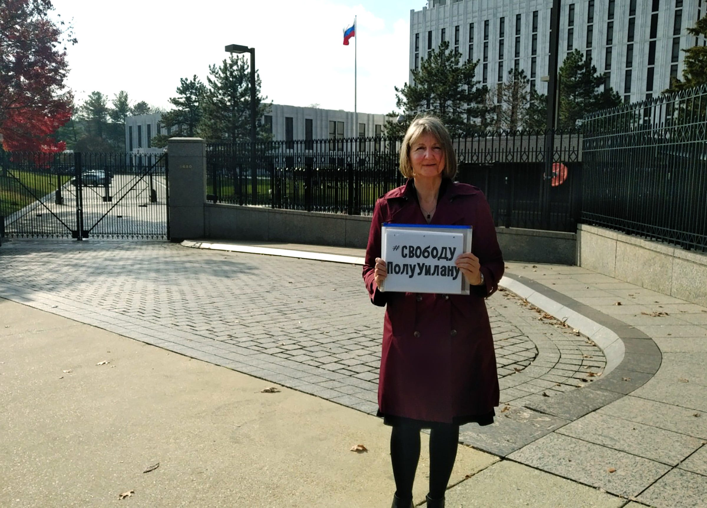 Elizabeth Whelan holds up a sign that says #FreePaulWhelan in Cyrllic in front of the Russian embassy in Washington, D.C. She's the sister of Paul Whelan, the Michigan man who is accused of spying in Russia.