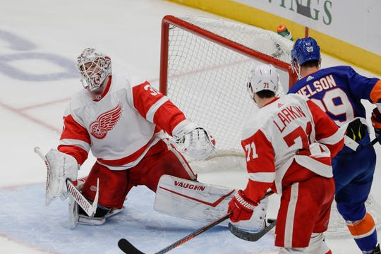 Detroit Red Wings goaltender Calvin Pickard, left, reacts after a puck shot by New York Islanders Anthony Beauvillier gets past him for a goal as teammate Dylan Larkin (71) and New York Islanders' Brock Nelson (29) watch during the third period of an NHL hockey game Tuesday, Jan. 14, 2020, in Uniondale, N.Y. The Islanders won 8-2. (AP Photo/Frank Franklin II)