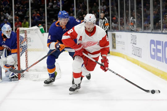 Detroit Red Wings' Justin Abdelkader (8) looks to pass away from New York Islanders' Scott Mayfield (24) during the first period of an NHL hockey game Tuesday, Jan. 14, 2020, in Uniondale, N.Y. (AP Photo/Frank Franklin II)