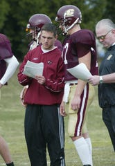 Central Michigan graduate assistant Matt LaFleur goes over a play with quarterback Grant Arnoldink in a practice during the 2004 season.