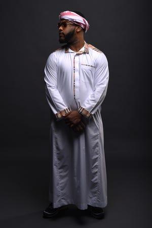 A man wearing a thobe