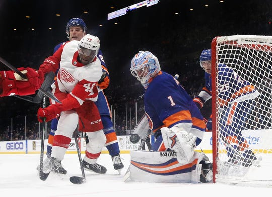 Thomas Greiss, seen here making a save on Detroit Red Wings forward Givani Smith, is a possible candidate to be one of the Wings' goaltenders next season.
