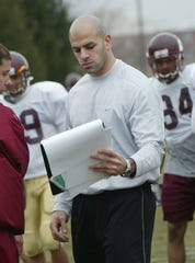 Central Michigan defensive assistant Robert Saleh goes over a play during practice in the 2004 season.