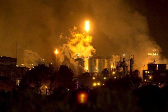 Smoke rise following a big explosion at an industrial hub near the port city of Tarragona, Spain, Tuesday, Jan. 14, 2020.